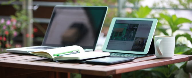 laptop and tablet on a desk